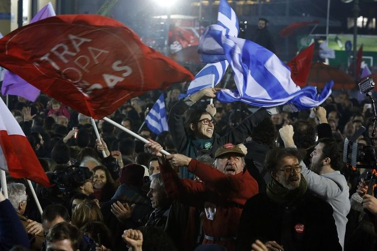 Supporters of Syriza leader Alexis Tsipras celebrate in Athens on Sunday as news emerges that...
