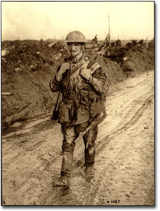 A Canadian Tommy soldier covered in mud returning from the front lines, [ca. 1918]   Unknown photographer.