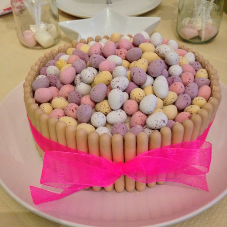 White chocolate finger cake - Victoria sponge covered with buttercream and decorated with white chocolate fingers, cadbury's mini eggs and ribbon - birthday cake