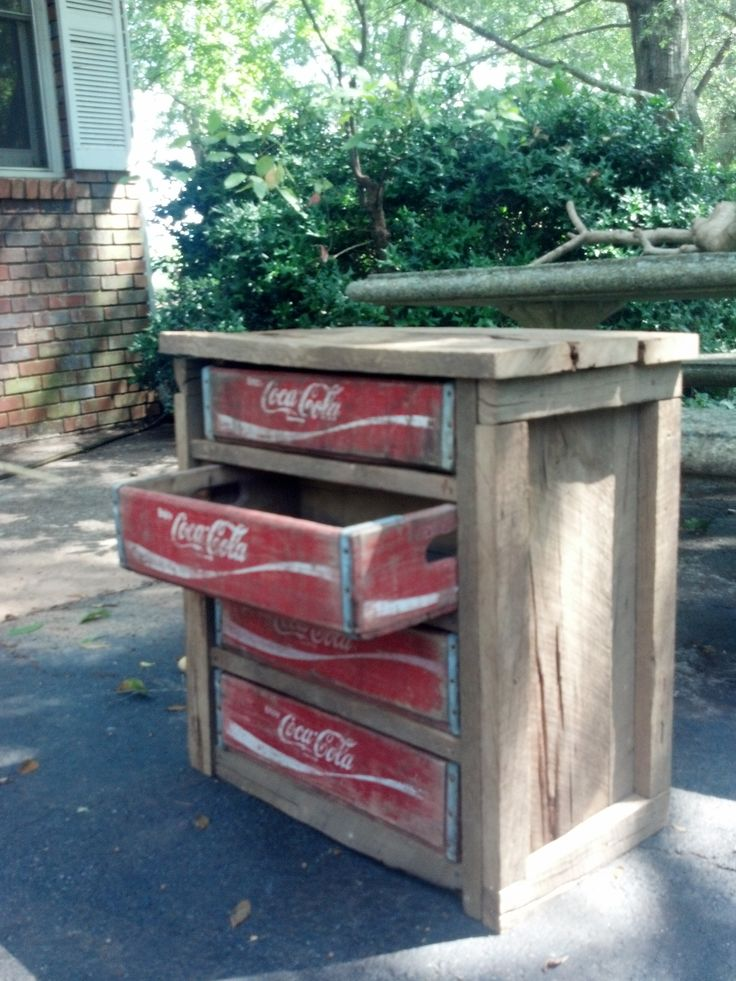 Upcycled dresser made from old barn wood and vintage Coca Cola crates.