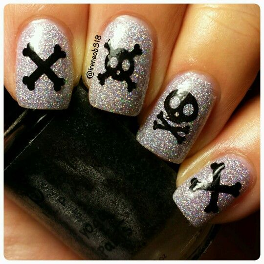 day 24: bones #clairestelle8oct  Aaargh...these look like pirate nails to me.  Love this Holo-Daze by @upstatelacquers! #ciciandsisi plate 4 using Yoga Pants by @dripdropnailpaint. @glistenandglow1 my favorite HKgirl and I cleaned up with my @cosette.nail.shop brush and used my Petite stamper.