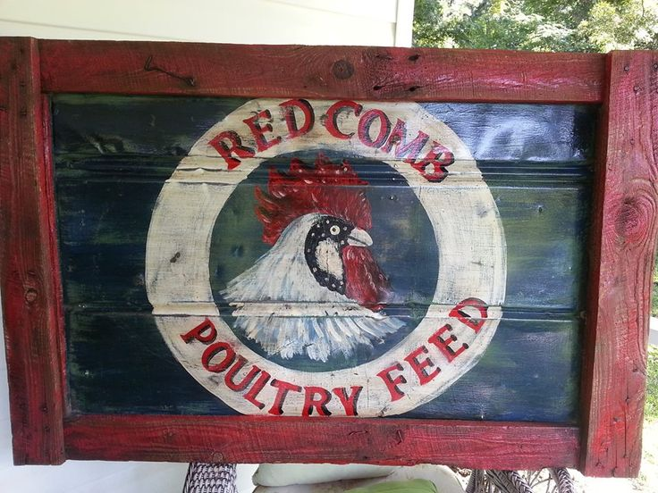 Vintage Feed sign hand painted on an old metal barn door by owner Tim Adams..lovely Rustic Farmhouse decor!