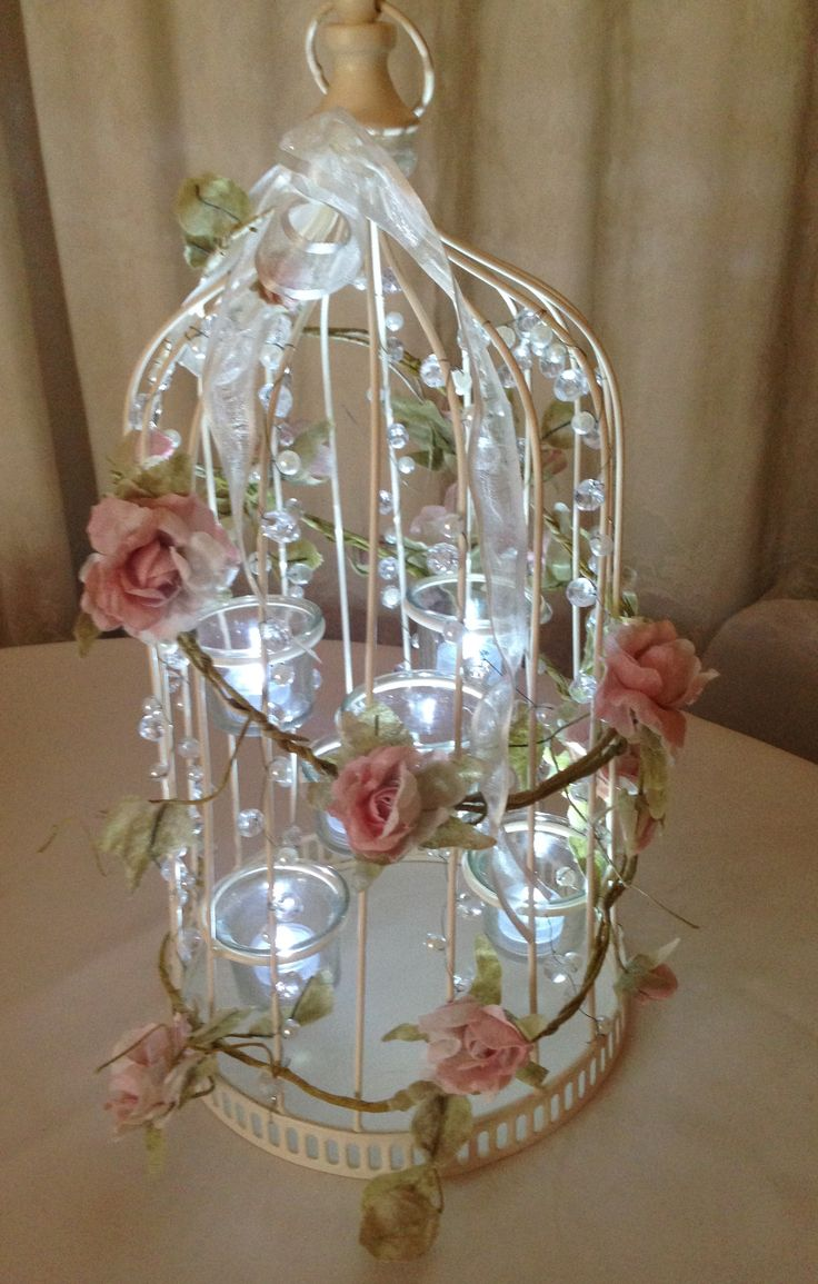 Rustic/vintage style birdcage can be hired in The Midlands from Make It Special Events. http://www.makeitspecialevents.co.uk/