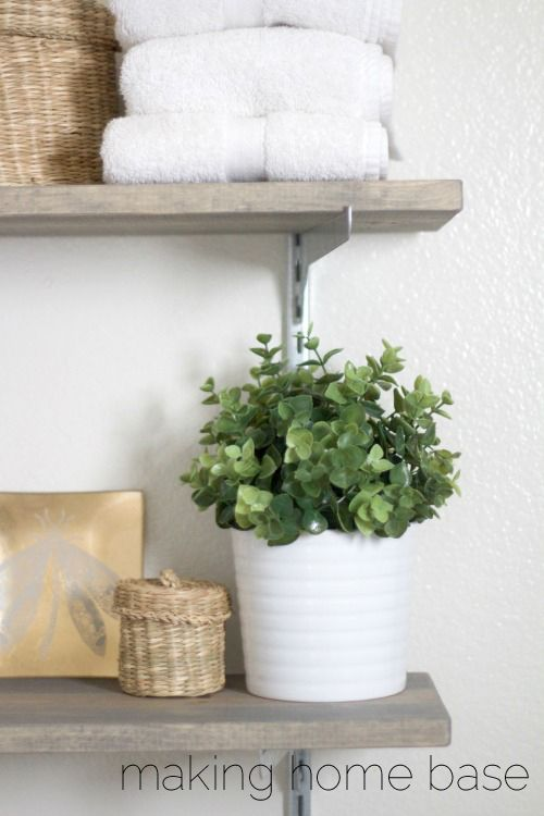 Shelving is a quick storage solution for any space. Create bathroom storage in a flash with some easy industrial style shelves.