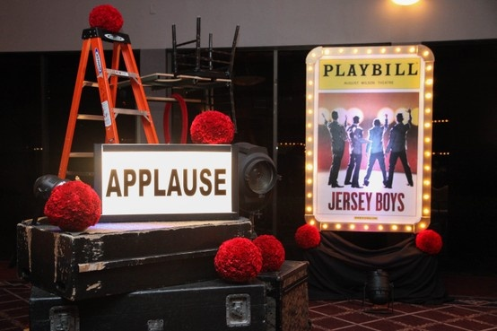 Broadway inspired props used to transform the room into a backstage atmosphere.