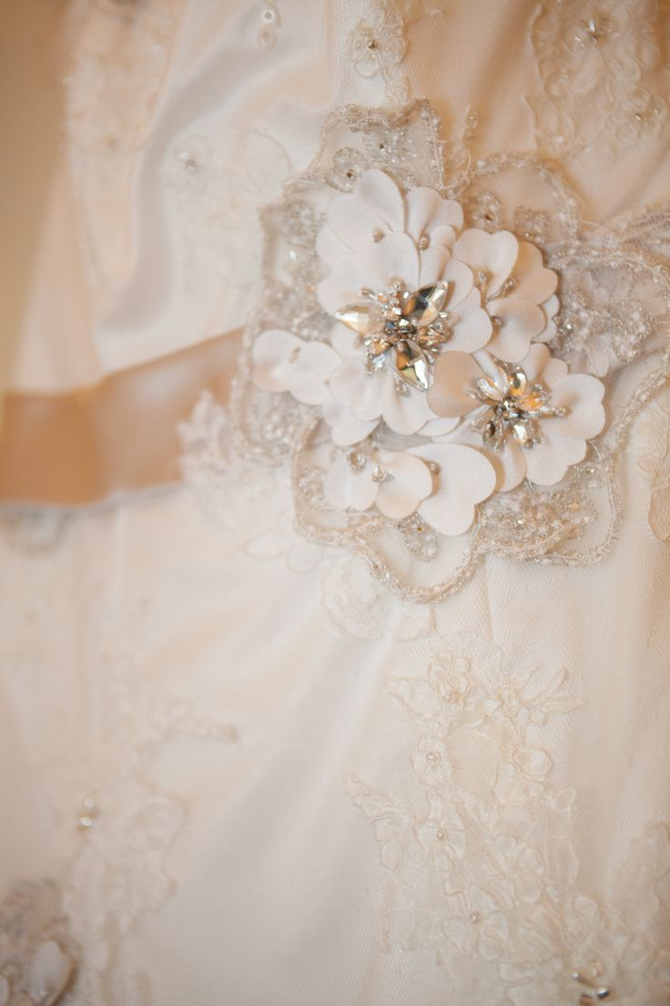 Maggie Sottero Geneva mocha belt close up on flower detail In-Lace Photography