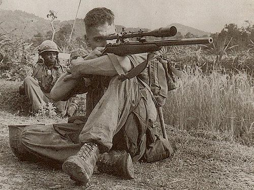 semperannoying:  Gunnery Seargent Carlos Hathcock, pictured here, zeroes in on one of his 93 confirmed kills.