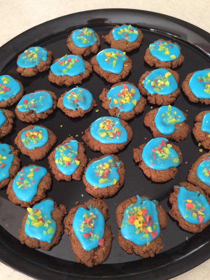 My sons ginger biscuits with blue icing and popping candy!