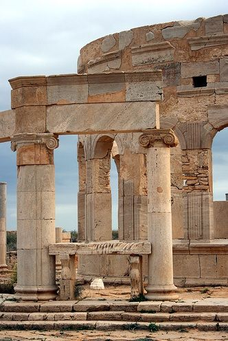 The ruins of the ancient city of Leptis Magna in Libya.  located in Khoms, Libya, 130 km (81 mi) east of Tripoli, on the coast where the Wadi Lebda meets the sea. The site is one of the most spectacular and unspoiled Roman ruins in the Mediterranean.