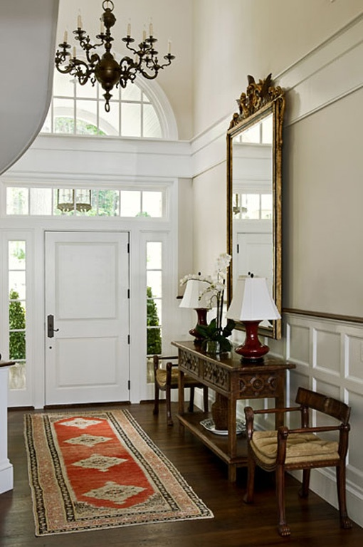 Best hallway table decor with lamp and jars house with large hallway decorated with dark wooden table also big mirror and black chandelier with rug