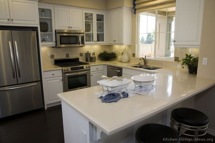 Kitchen idea of the day traditional white kitchens for Small kitchens with white cabinets