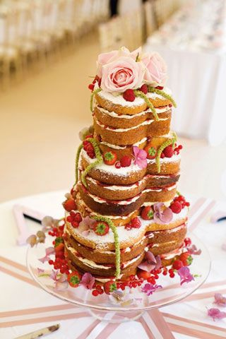 heart-shaped vanilla sponge cake with flowers and raspberries