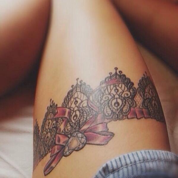 Pink bow, garter tattoo