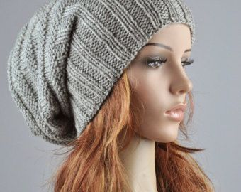 "This hat features on an cable pattern and suits any outfit style. It is made of soft wool blend yarn in nice grey color.  Length:11"" from top to bottom Circumference: 18"" (relaxed) 24"" (stretched) – fit any size head!  Hand wash in cold water with detergent or shampoo and lay flat until dry.  It is knitted in my pet-free and smoke-free home.This one is in stock and ready to shipping."