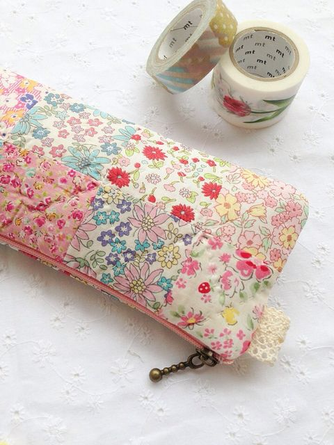 pretty Liberty looking patchwork zip pouch. Its spring finally:) {front of case}