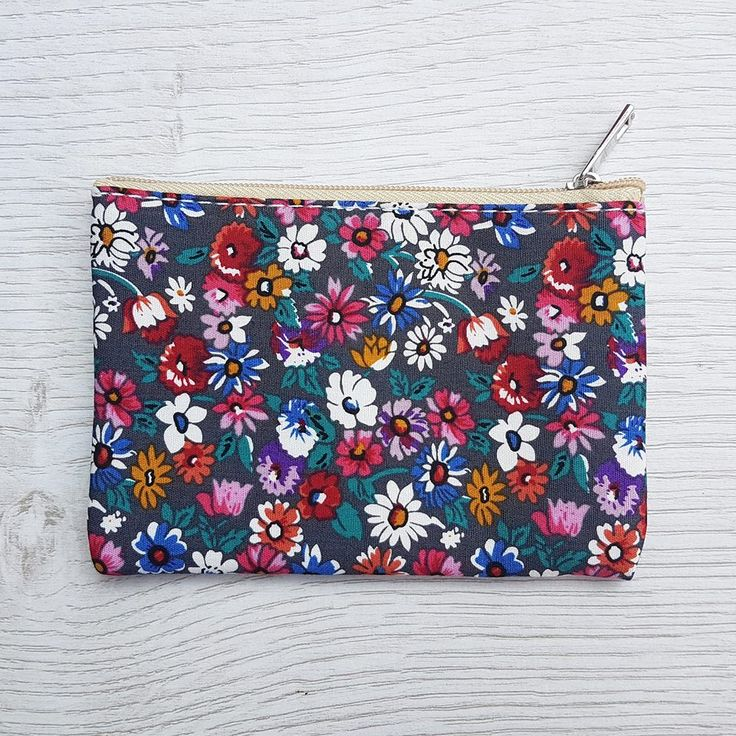 These cute canvas purses are the perfect size for your coins, cards, lipsticks or those girly essentials!  A great gift idea for a girl of any age - why not fill it with her favorite lipgloss, piece of jewellery, sweets or a giftcard!  Neutral zip fastening to secure your essentials and fully lined, giving your contents extra protection.  All coin purses come lovingly wrapped in pink tissue sealed with an Annie's Closet label.  Size: 12.5cm x 8.5cm.