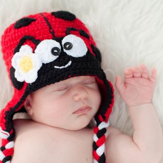 Keep your little bug warm and cozy with our adorable Ladybug beanie. Beautifully handmade with 30-percent milk protein fiber and 70-percent cotton, all in a smoke free environment. Style: baby ladybug