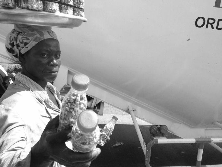 https://flic.kr/p/zoX4CE | Roadside Hawking Cashews | Roadside hawking cashews and peanuts in Tema, Ghana.  #JujuFilms