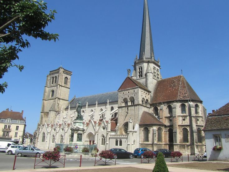 The statue of Napoleon stands beside the Notre Dame church in Auxonne.