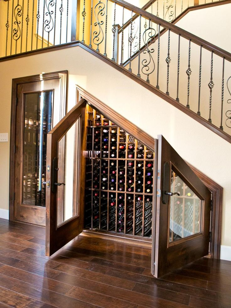 Wine Rack - Give new life to the space beneath your stairs with a custom wine cabinet. This example from Vino Cellars Accessories matches the homes traditional decor. The major benefit of this space-saving storage solution? Its temperature controlled to keep wines at peak enjoyment.