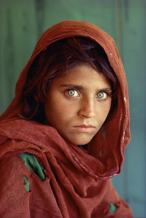 The Afghan Girl  - Steve McCurry.  I still remember seeing this picture on the cover of Nat'l Geo or Time Life (can't remember which) when I was young. It left a great impression upon me...