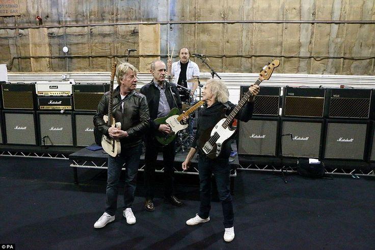 The original members of Status Quo (left-right) Rick Parfitt, Francis Rossi, Alan Lancaster and John Coghlan (rear) practice at Sheperton Studios in Surrey in 2013