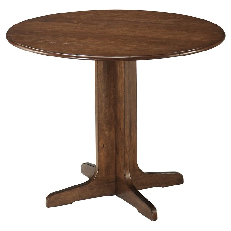 Stuman round dining room table offers those short on space nice leeway. When friends or family drop in, raise the drop-down leaves for ample tabletop space.  Signature Design by Ashley is a registered trademark of Ashley Furniture Industries, Inc.