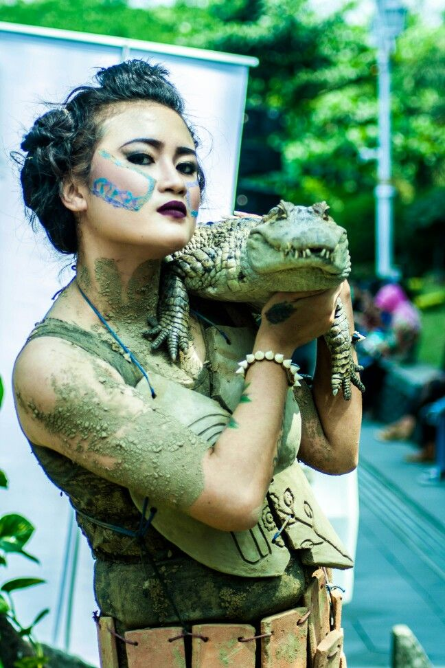 Women and crocodile