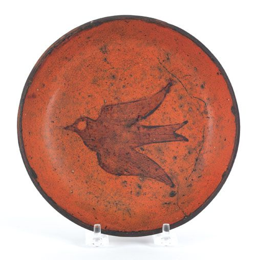 "Pook & Pook. November 11th & 12th 2011. Lot 57. Estimated: $500 - $1000. Realized Price: $889. Pennsylvania redware plate, 19th c., with flying bird decoration, 7 3/8"" dia."