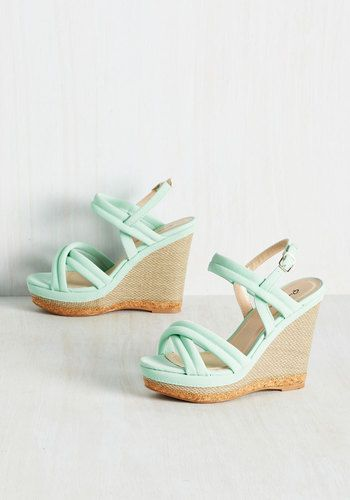 It's said that variety is the spice of life, and boy, do these mint wedges make things flavorful! The cushy matte straps of this peep-toe pair intermingle with a sleek, woven wedge - and, trimmed with cork-inspired piping around the sole, these potent kicks are the pinnacle of whimsical.