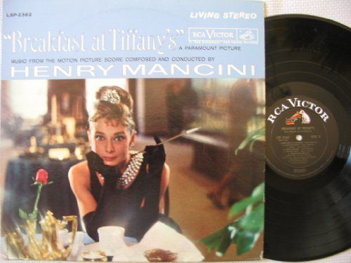 """HENRY MANCINI [Composer] ~ 1961 """"Breakfast At Tiffany's"""" commercial stock STEREO vinyl album soundtrack release (RCA Victor LSP-2362) in NEAR-MINT COND. (no marks, no scratches, no fingerprints).  The film won two Oscars for Best Original Score and Best Original Song (""""Moon River""""), and starred Audrey Hepburn and George Peppard.  ($29.99)  Amazon.com"""