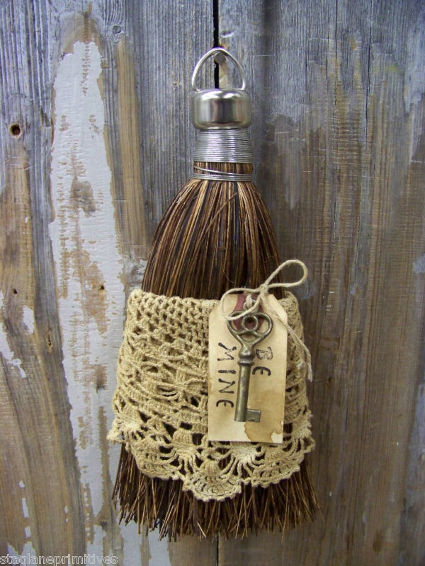 Dress an old whisk broom in lace...  ...for that 'prim and proper' look...
