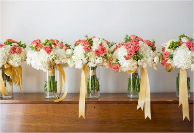 I like the idea of putting the bouquets in jars at the reception