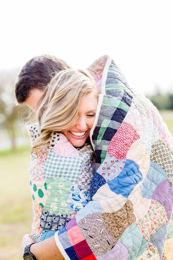 Cute! Warm up fall or winter engagement sessions with a sweet blanket | http://www.weddingpartyapp.com/blog/2014/10/30/cold-weather-engagement-photos-outfit-guide/