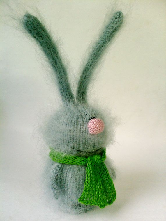 Bunny is a very soft and fuzzy migurumi toy. He is knitted of gray mohair and yarn with safety black eyes and stuffed with polyfil. Nice knitted