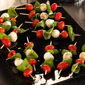 Caprese Salad Kabobs ...This appetizer is more creative than a veggie platter and healthier than chips and dip. I often make it for my family to snack on, and it's a great recipe for the kids to help with.