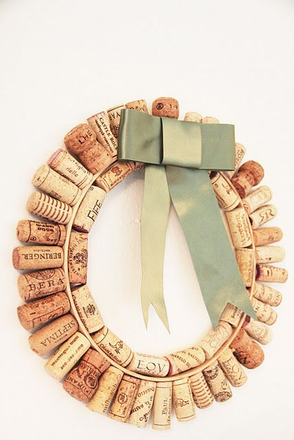 Wine Cork Wreath start with an embroidery hoop   Then  gathered all your  supplies and lay out the corks to decide what pattern  you want Then  start gluing. Outside first Then the inside  you can add a ribbon or flowers