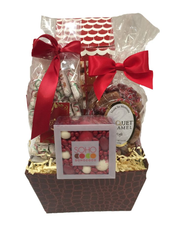FIRE - Reusable high back brown box with white chocolate tree pretzels, assorted gourmet caramels, sohococo enrobed chocolate and candy covered nuts and seeds, and a box of milk chocolate dipped gingerbread mini men.