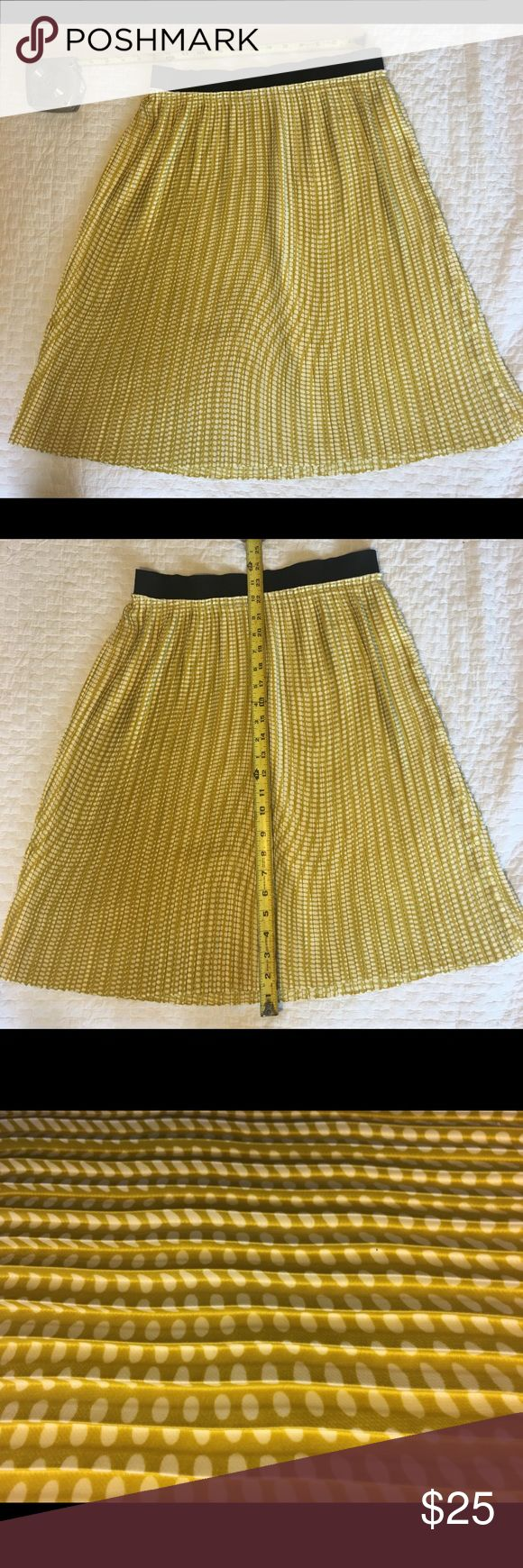 Benetton Box Pleat Skirt Versatile box pleated skirt in yellow with white polkadot. Features black elastic waistband.  Can easily be treated as a neutral to pair with almost anything! EUC Skirts Midi