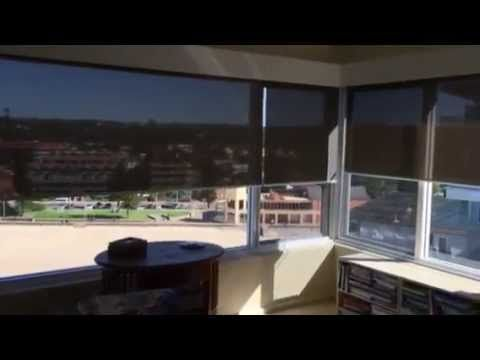 Motorised Roller Blinds in Operation. All Blinds by Peter Meyer Simply Roller blinds can be motorised and can achieve the smallest fabric gaps in the market.  Blinds by Peter Meyer: Australia's best Custom Made blinds.