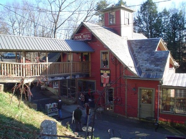 """The Book Mill, Montague, Massachusetts, US. The bookstore is housed in an 1834 gristmill and still has a waterfall running down the side of it. The Book Mill's motto is: """"Books you don't need in a place you can't find"""" :)"""