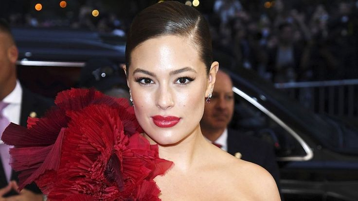 """9:10 AM PDT 8/7/2017 by Sam Reed      Bet they regret it now.  Ashley Graham made a sexy splash when she arrived at the 2017 Met Gala in a H&M couture gown featuring a fiery red and burgundy train of florals and a va-va-voom cream bustier. Even Rihanna told her she looked """"hot as... #2016 #Ashley #Designers #Dress #Gala #Graham #Met #Skipped"""