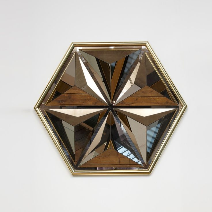 An incredible focus piece in any room. Multi faceted mirror wall sculpture 1970
