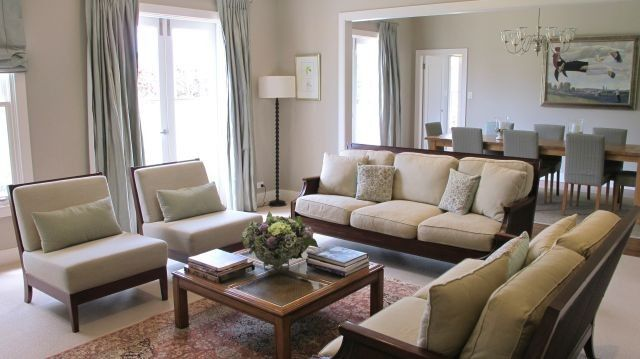 open dining room into living room set up w/ 2 sets french doors; I like the way they separated the two rooms