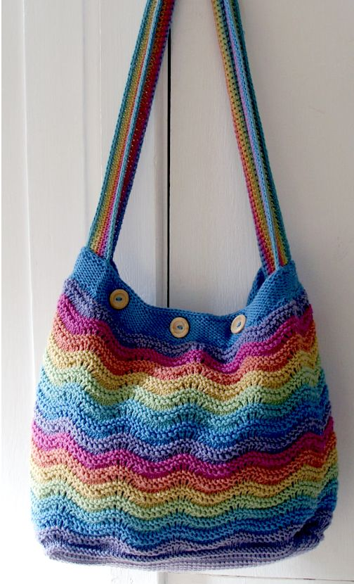 Free Knitting Pattern for Feather & Fan Rainbow Ripple Beach Bag Roomy tote bag with feather and fan stripes. Designed by Home Baked Online. Perfect for mini skeins of DK yarn.