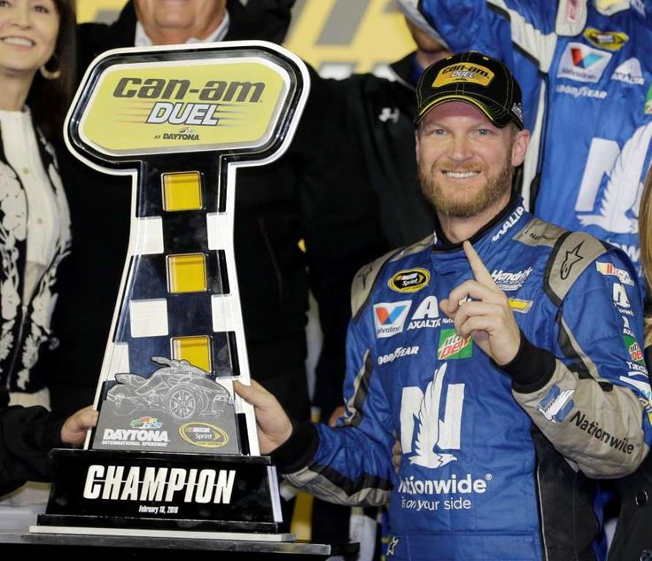 © AP Photo/Terry Renna Dale Earnhardt Jr poses with the trophy in Victory Lane after winning the first of two qualifying races for Sunday's NASCAR Daytona 500 Sprint Cup series auto race at Daytona International Speedway in Daytona Beach, Fla., Thursday, Feb. 18, 2016.