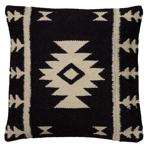 It's makeover time! Revamp your couch or bed with the abstract Black/Ivory Southwestern Stripe Throw Pillow by Rizzy Home. The abstract stripes on the black background is a sure-shot eye catcher. It is made out of a of cotton-wool blend, filled with polyester making it plush and sturdy. Kick back with a good book or snuggle with your loved one with this super comfy pillow!