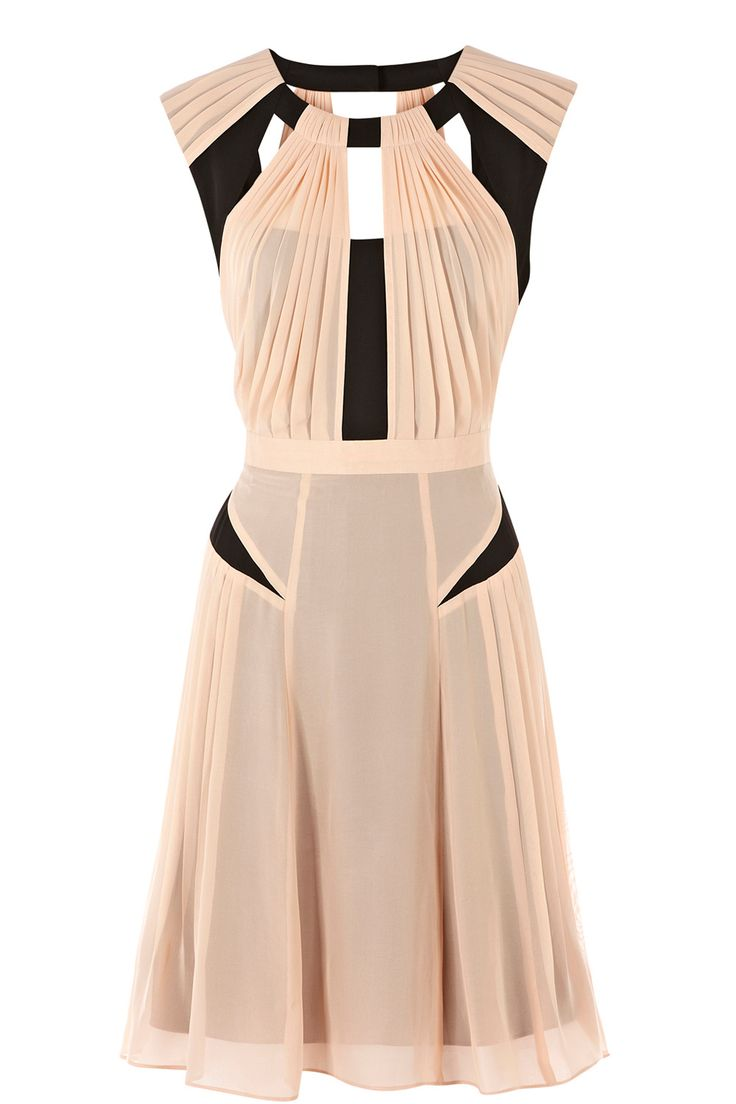 cut-outs and color blocking come together to create a beautiful dress.