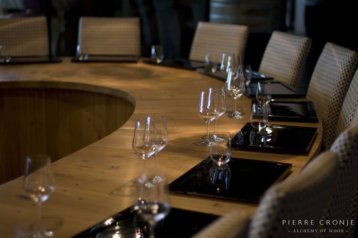 The private tasting room at Leopards Leap in Franschhoek, South Africa. Interior design by Christiaan Barnard, solid wood furnishings and shopfitting by Pierre Cronje