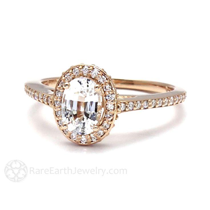 White Sapphire Engagement Ring Oval Halo Setting 14K 18K Gold or Platinum Bridal Jewelry Diamond Alternative by RareEarth on Etsy https://www.etsy.com/listing/115739593/white-sapphire-engagement-ring-oval-halo